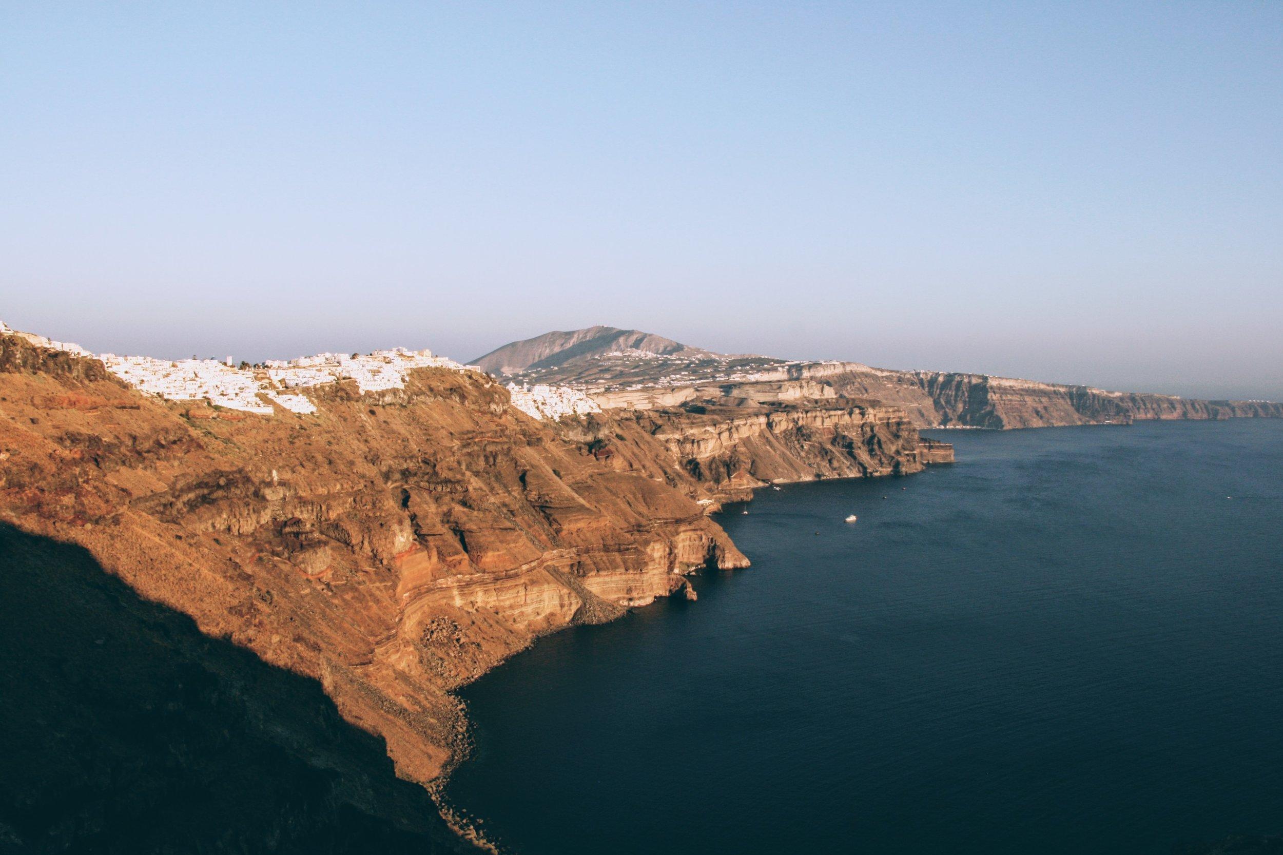 Hanging off the volcanic cliffs of Santorini